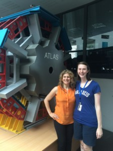 With physics PhD student Hannah Herde and a scale model of the ATLAS detector